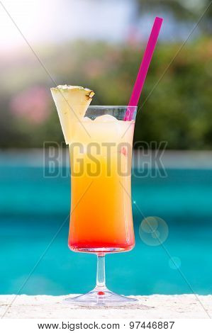 Glass of Cinderella kids cocktail with sunlight bokeh on the pool nosing at the tropical resort. Vertical poster