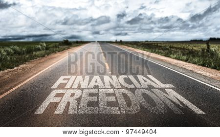 Financial Freedom written on rural road