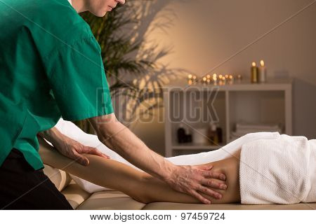 Woman having smoothing and anti-cellulite legs massage poster