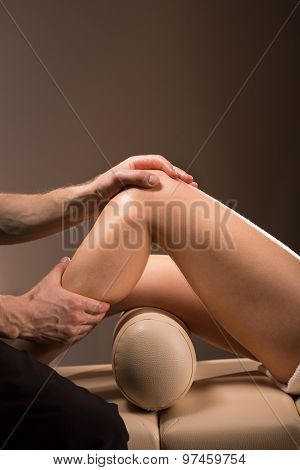 Therapeutic massage performed to numb the knee pain poster