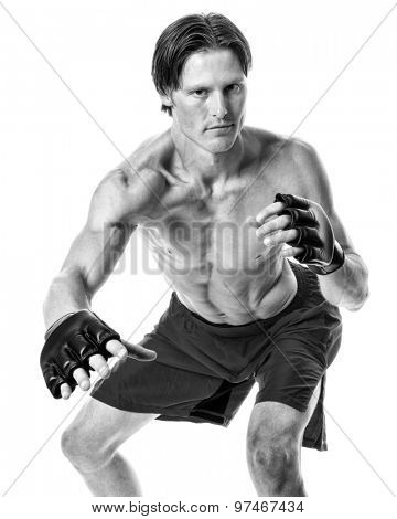 Young adult martial artist. Studio shot over white. Black and white.