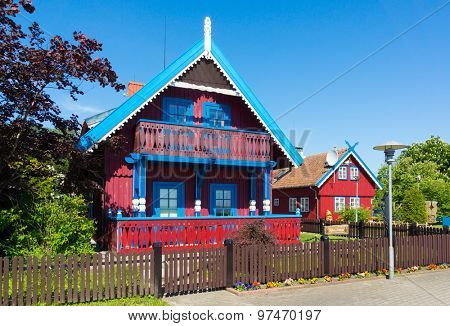Nida. Traditional fisherman's house in Nida, Lithuania. Nida is a resort town in Lithuania. Located on the Curonian Spit between the Curonian Lagoon and the Baltic Sea. Unesco Heritage. poster