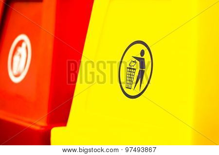 Yellow Garbage Pail With Sign