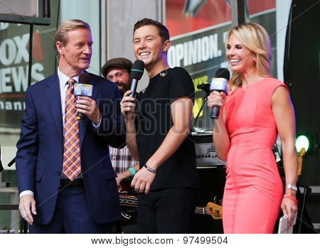 NEW YORK-JUL 31: Country music artist Scotty McCreery performs onstage at Fox and Friends' All-American Summer Concert Series at 48th Street and 6th Avenue on July 31, 2015 in New York City.