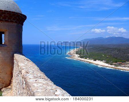 old fortifications on a rocky promontory in Santiago de Cuba