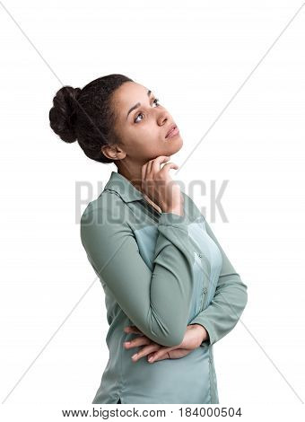 Isolated portrait of a pensive African American woman wearing a green shirt and looking upwards with a hand near her chin.