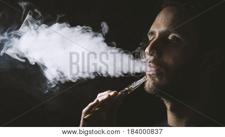 Holding Vaping Device Or Electronic Cigarette