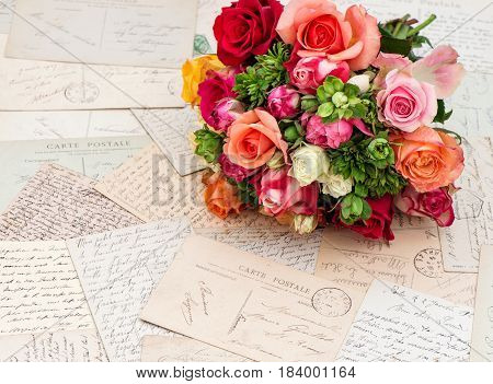 Rose flowers and vintage letters. Nostalgic romantic paper background