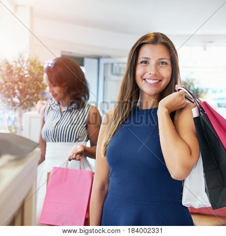 Cute Woman Shopping With Friend At Store