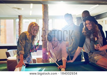 Female Pool Player Taking Aim At The Cue Ball