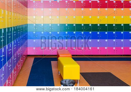 The wall is decorated with multi-colored storage chambers. A variant of the interior for children's rooms shops gambling halls. Numbered cell storage in a baggage room