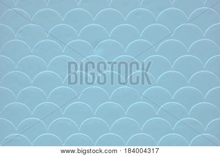 Light blue fish scale seamless pattern on decorated cement wall