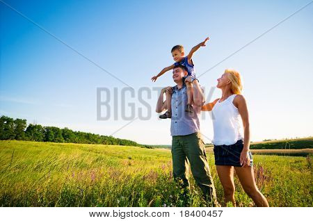 happy family having fun outdoors poster