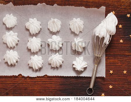 Top view of hite raw meringue made of whipped eggs ready to bake