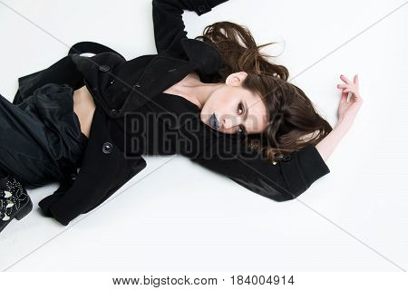 Girl With Beautiful Hairstyle In Coat Has Black Makeup