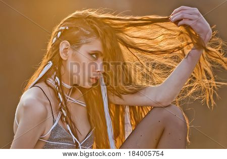 Young Pretty Woman With Rope In Dreadlocks In Hair