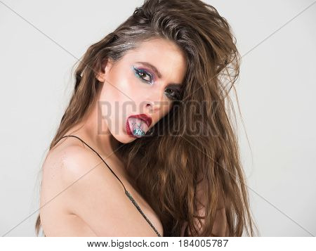 Girl With Fashionable Glitter Makeup And Red Lips Showing Tongue