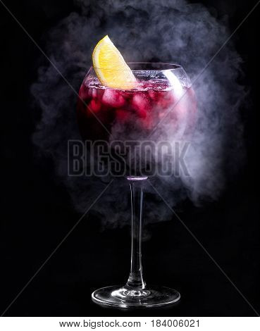 Cocktail. Dark Red Cocktail With Ice And A Slice Of Lemon. A Cocktail In The Smoke.