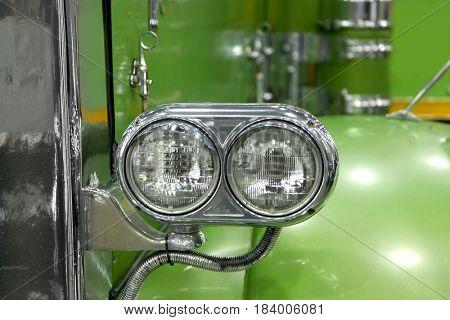 Head lamp of classic green semi truck