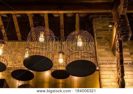 Birdcage lamps hanging on