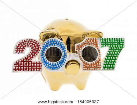 Piggy bank standing on the with a shape of 2017 glasses