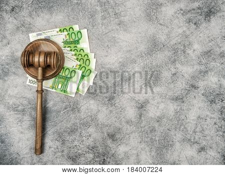 Judges Gavel on a stack of euro cash money. Auctioneer hammer with Soundboard