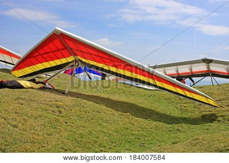 Hang Gliders prepared to launch from a hill
