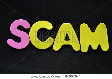 scam word on a  abstract colorful background