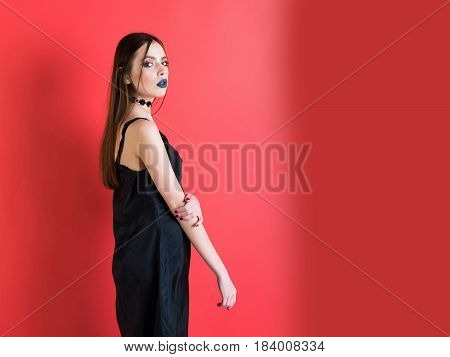 Girl With Beautiful Hairstyle In Dress Has Black Makeup