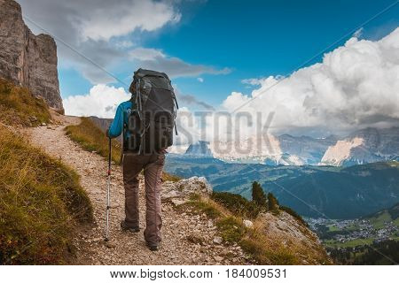 hiker on footpath in Sella Ronda mountain south Tyrol, Italy
