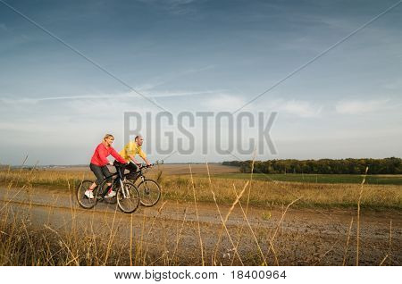 two cyclist relax biking at sunset