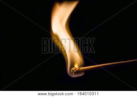 One quiet burning match on black background. Match burning details