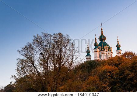 Church on a background of autumn trees and blue sky
