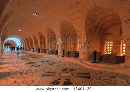VERDUN FRANCE - AUGUST 19 2016: Visitors in the Douaumont Ossuary a memorial containing the remains of soldiers died during the Battle of Verdun in First World War One.