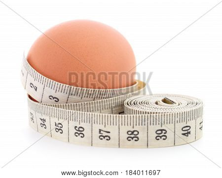 Egg and measuring tape on a white background.