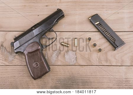 Makarov Pistol With Bullets And Cartridge On The Wooden Surface, Set