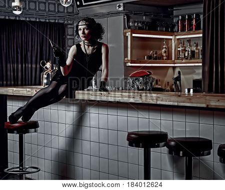 Chicago girl with a cigarette at the bar counter