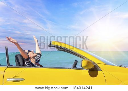 Summer car trip vacation . Yellow car at background of sea water. Travel, freedom and holidays concept.