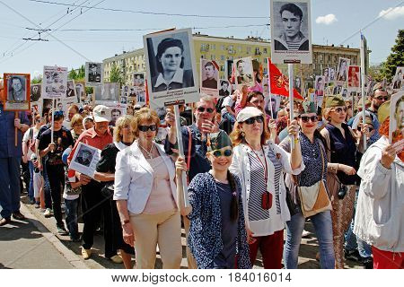 Volgograd Russia - May 09 2016: People hold portraits of their relatives in the action