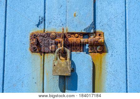 Old Rusty Padlock On Wooden Doors, Old Blue Destroyed Door, Rust Streak On The Door