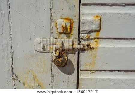 Old Rusty Padlock On Wooden Doors, Old White Destroyed Door, Rust Streak On The Door