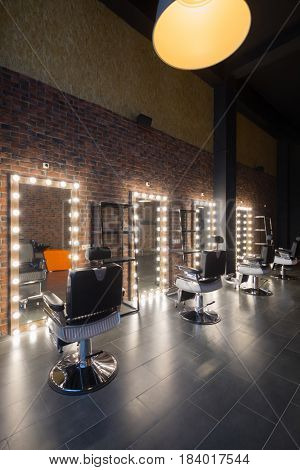 Dressing room with places for hairdresser and make-up artist work - seats and mirror with illumination