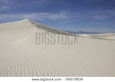 the ridge and crest of a white sand dune
