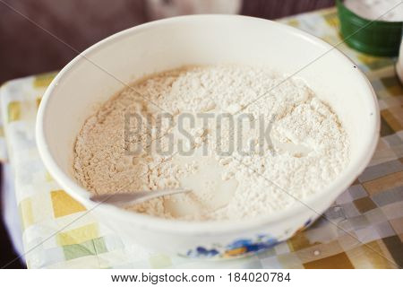 Preparing batter for pancakes on the kitchen