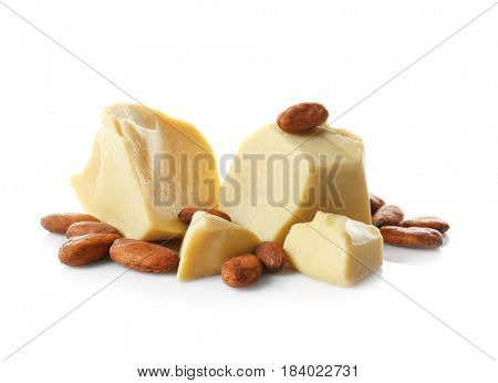 Aromatic cocoa beans and butter on white background
