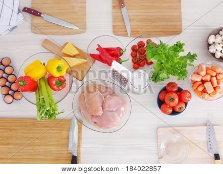 Fresh ingredients for cooking on table, top view