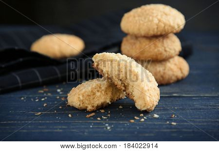Delicious coconut cookies on wooden table