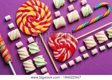 Composition with tasty sweets on color background, closeup