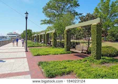 BEAUFORT SOUTH CAROLINA - APRIL 16 2017: People enjoying the swings and promenade of the Henry C. Chambers Waterfront Park located south of Bay Street in the Historic District of downtown Beaufort