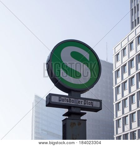 BERLIN GERMANY - February 14 2016: S-Bahn Urban Railway Station Sign Potsdamer Platz With Skyscrapers In The Background